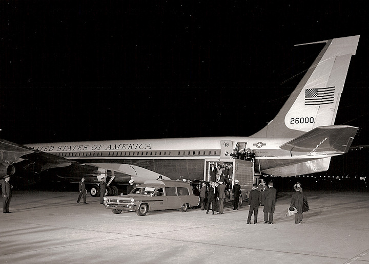 Jackie and Bobby Kennedy observe the offloading of the bronze Dallas casket, as they disembark Air Force One at Andrews AFB on 11/22/63.